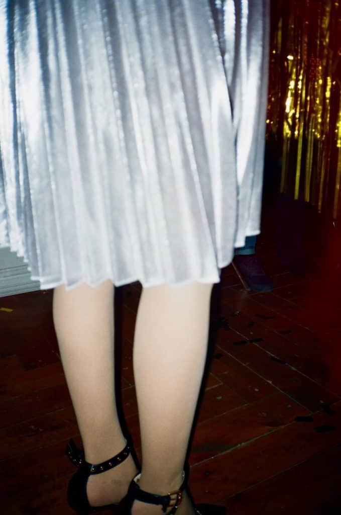 Photo of a lady on pleated skirt