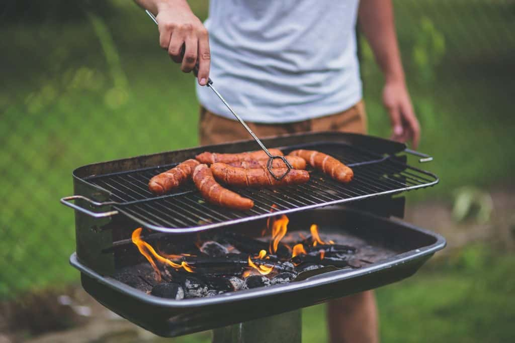 Photo of a hot dog being barbecued ; safe to eat by pregnant women
