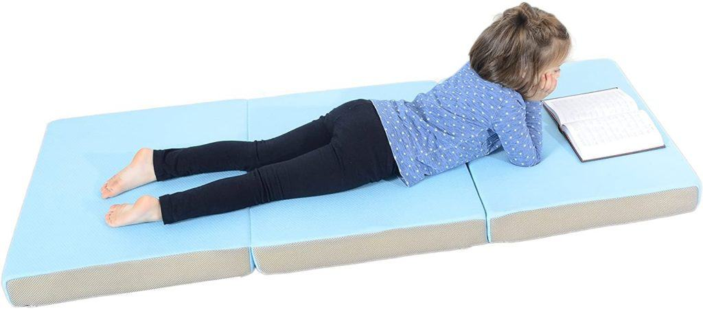 Photo of a girl lying on the Milliard Toddler Nap Mat
