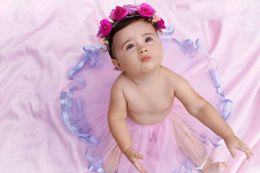 Photo of a beautiful girl with flowers around her head, some baby names mean beautiful flower