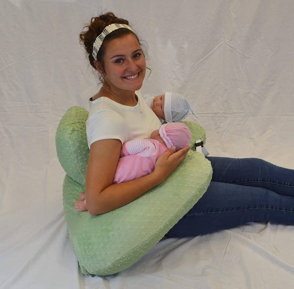 Photo of a mom with twins using a nursing pillow