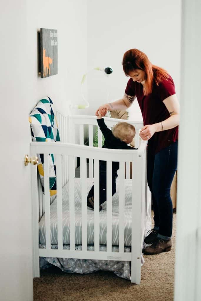 Photo of a mom with her baby in a crib