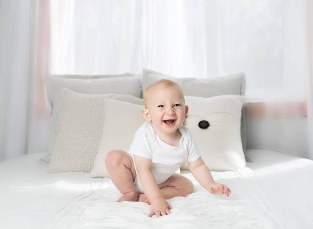 Photo of a baby sitting on Polyurethane foam