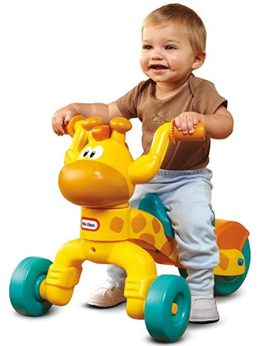 Photo of a boy on a Ride on toy for 1 year old