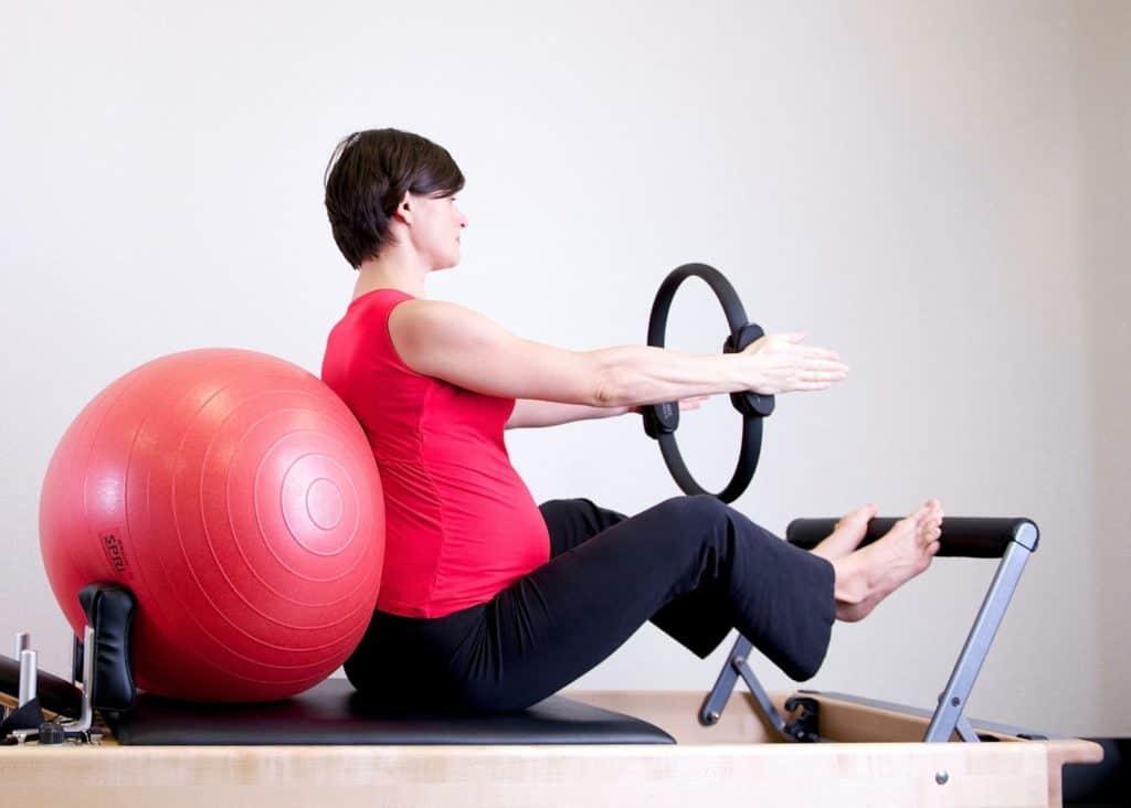 Photo of a pregnant woman doing prenatal workouts