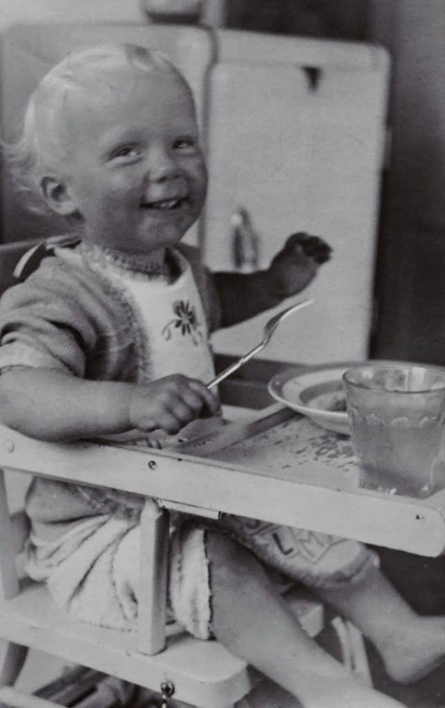 Photo of a baby on a folding high chair