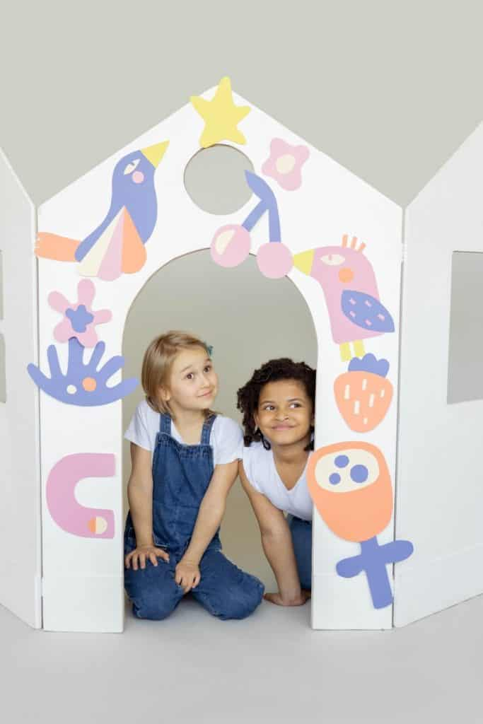 Photo of two kids in a playhouse