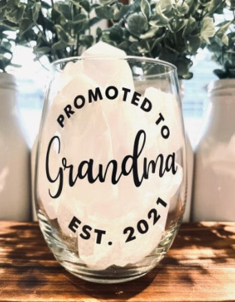 Photo of a cute wine glass; a nice pregnancy announcement gift for grandparents